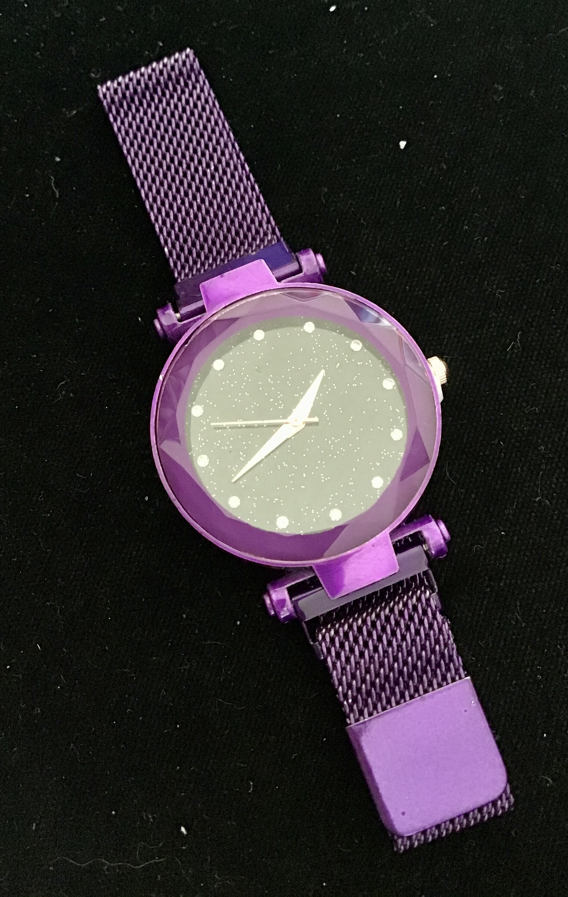 Purple watch with purple mesh band and energy disk