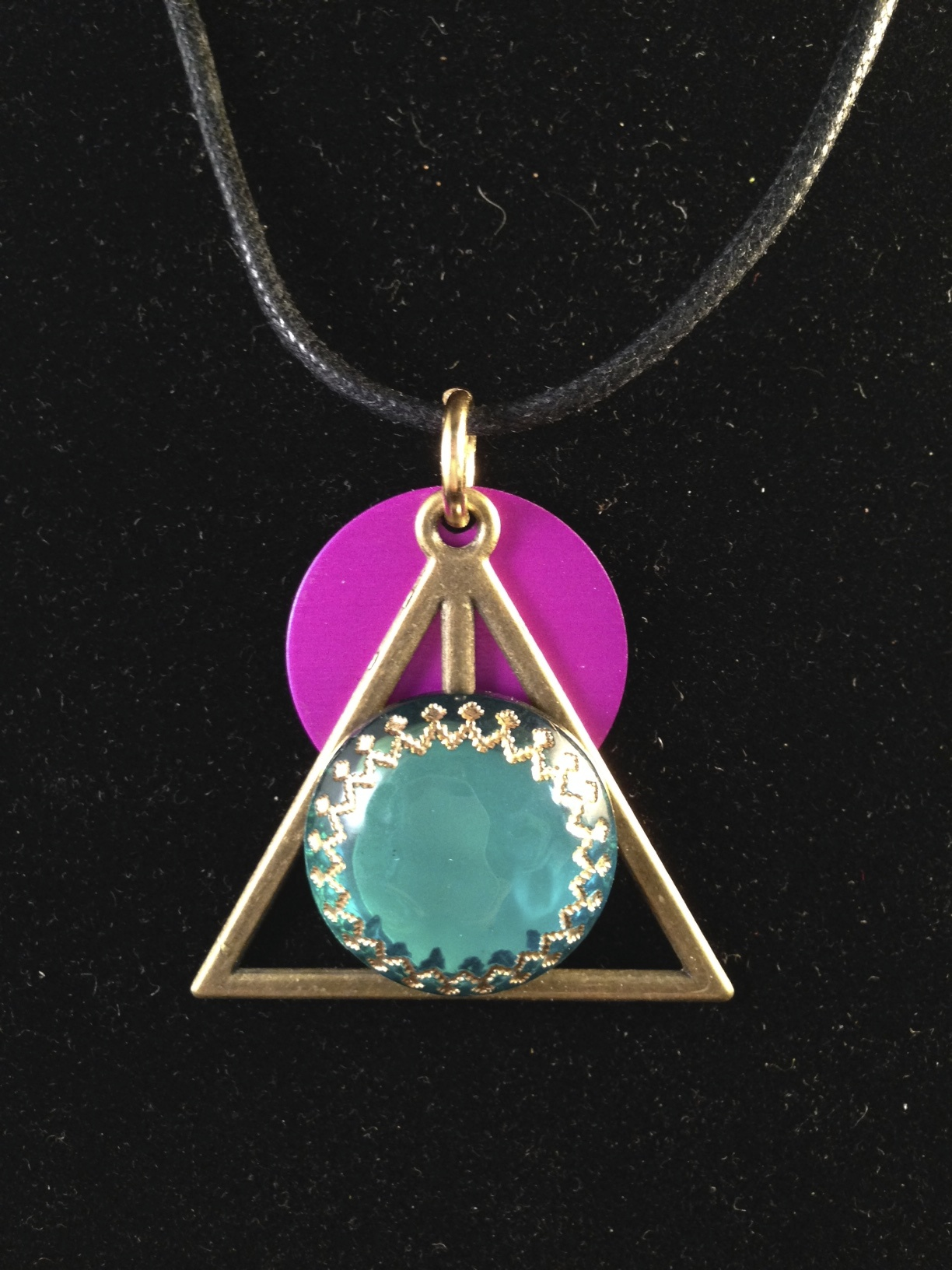 Triangle with Teal Jewel and Purple Energy Disk