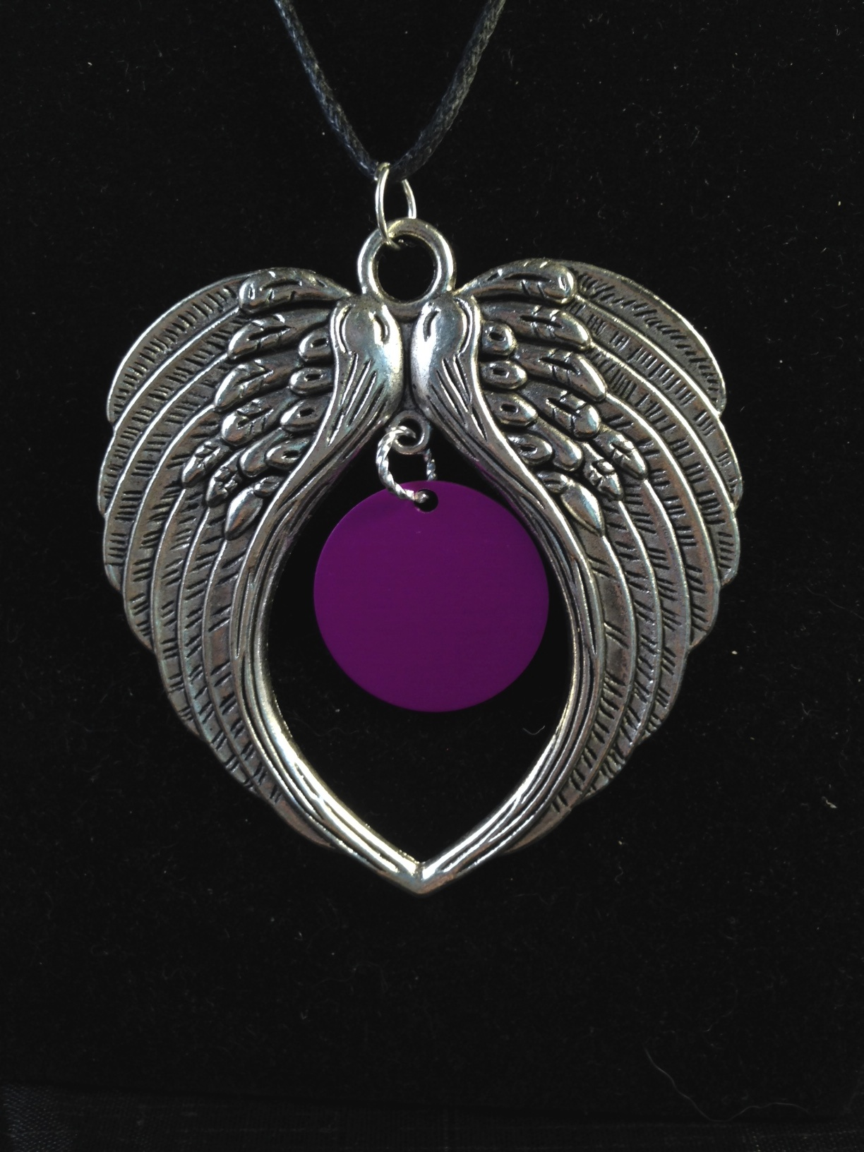 Large Wings Embracing Purple Energy Disk
