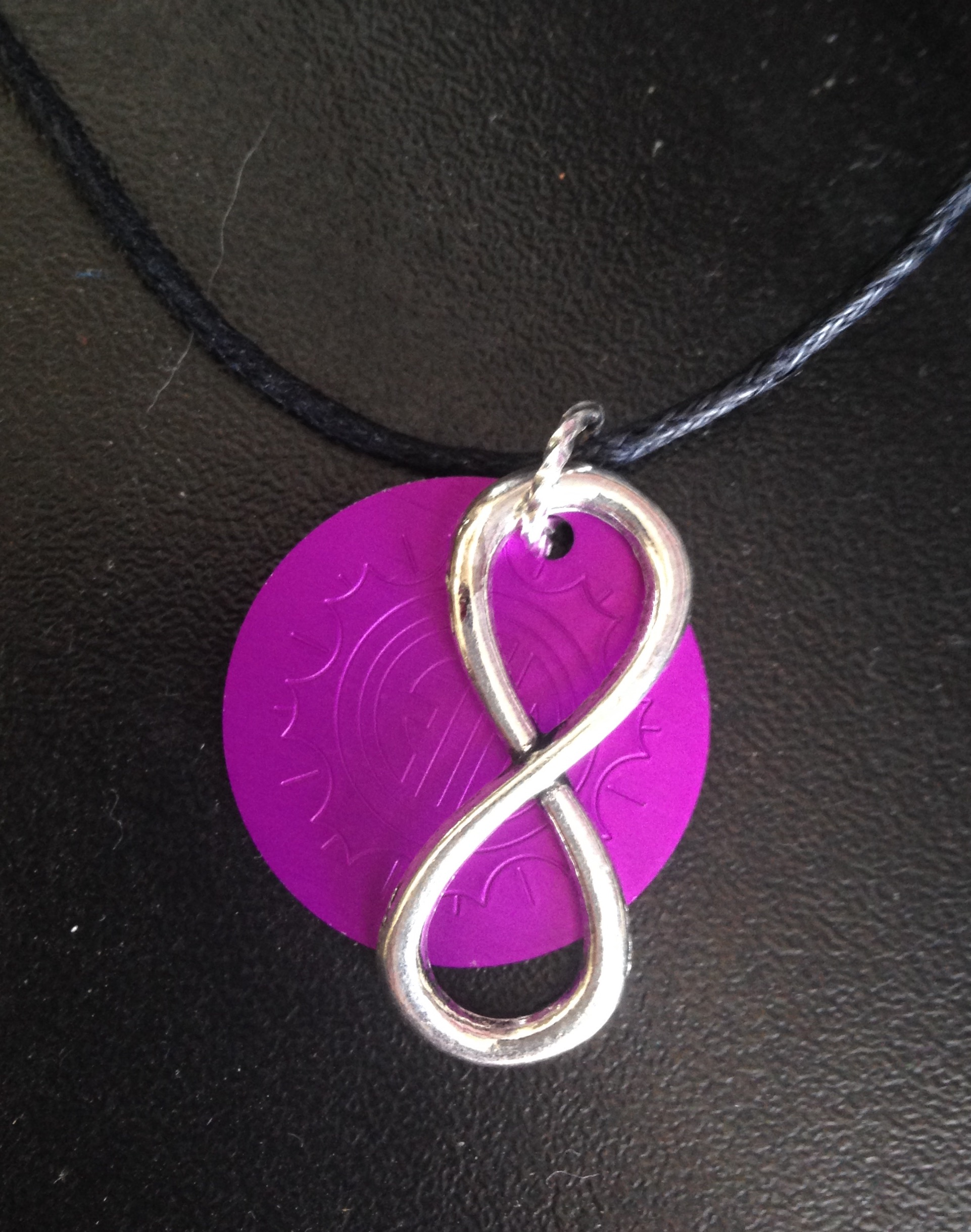 Silver Infinity Symbol with Purple Energy Disk