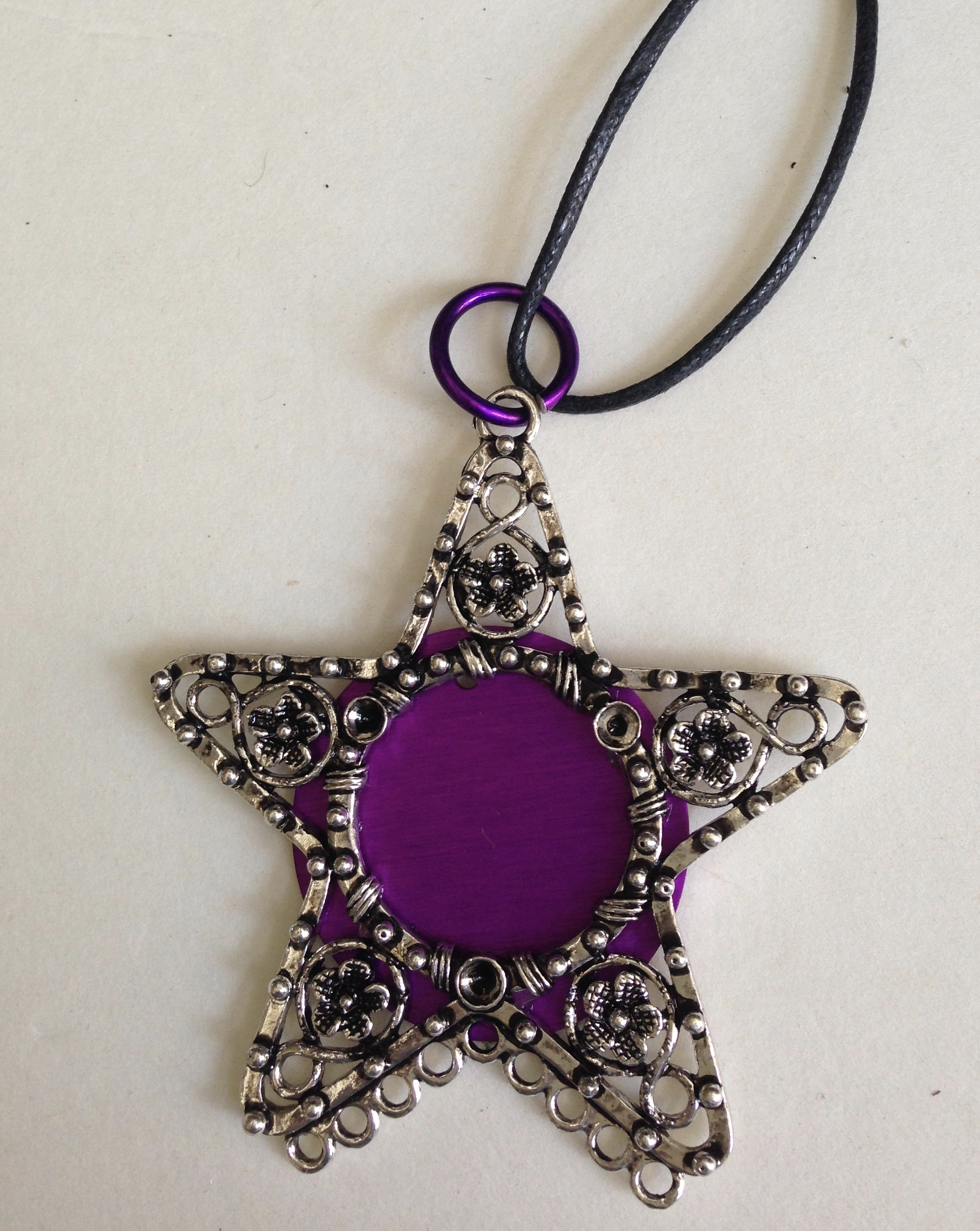 Silver Star with Large Energy Disk on black cord